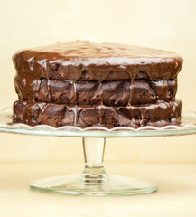 Delicious melted chocolate cake on brown background