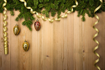 Christmas Wooden Background with fir tree, golden ribbon and dec