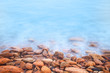 Shore of the sea, stones  and flowing water