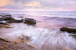 Colorful  Sunrise over the Sea and Rocky Coastline ,  flowing wa