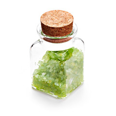 Green sea salt in glass bottle