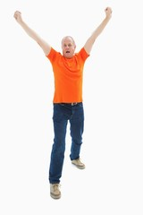 Mature man in orange tshirt cheering