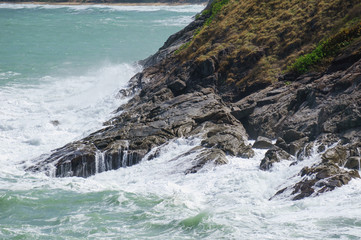 Stormy waves near a rocky shore