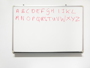 Literacy. Alphabet on real whiteboard in real classroom with rea
