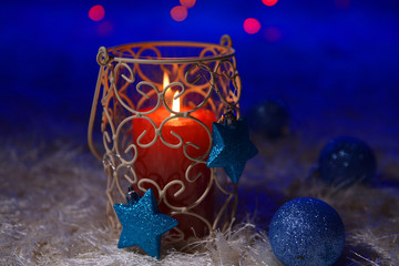 Candle on blur lights background