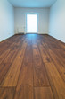Empty apartment interior with wooden floor after renovation