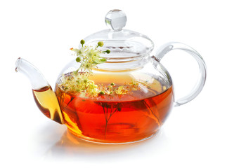 Teapot with linden tea and flowers on white background
