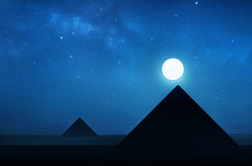 Ancient pyramids at night - night sky filled with stars