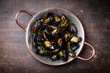 Leinwanddruck Bild - Boiled mussels in copper cooking dish on dark wooden background