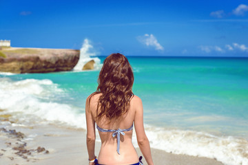 Sea girl on the beach is hair develop