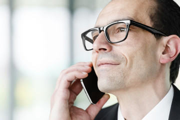 Eyeglasses Adult businessman talking on phone