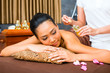 Beautiful Asian woman receiving massage