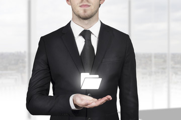 businessman holding folder symbol in open hand