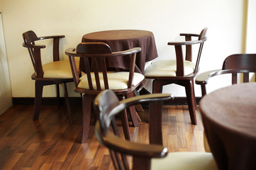 close up vintage wooden chairs and table in restaurant