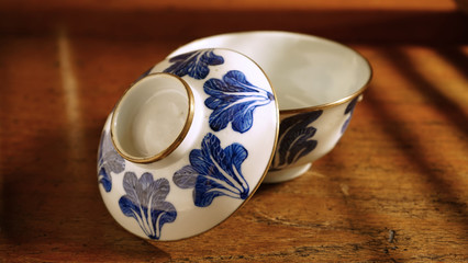 Chinese blue and white ceramic bowl on wooden table