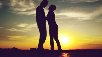 Lovers on a date in sunset, hugging and kissing. Romantic love s