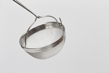 tea strainer on the white background
