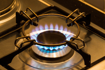 kitchen gas burner with blue flame