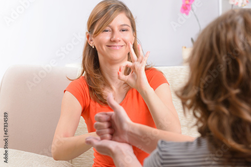 Deaf woman learning sign language - 67834589