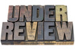 under review in wood type