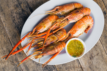 Grilled shrimps on white plate