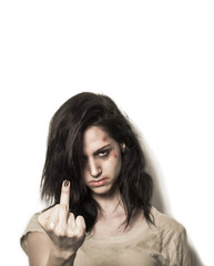 Beaten up girl showing middle finger