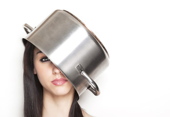 Girl wearing a pot as hat