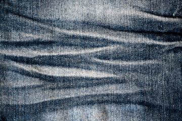 Close up photo of blue jeans fabric texture