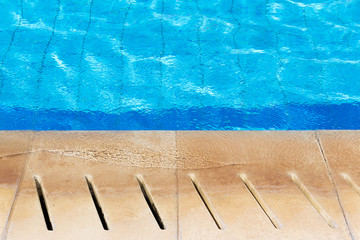 Calm water at the edge of a swimming pool.