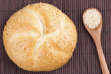 Sesame bread with sesame seed in spoon