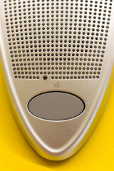 microphone speaker button on the yellow table