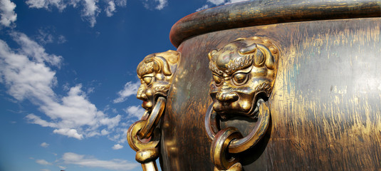 Large bronze bowl to extinguish fire with image Chinese dragon