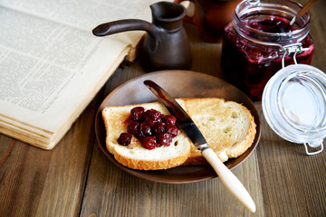 Romantic relaxing with a book and bread with jam