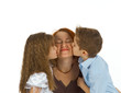 Happy mom kissed by children