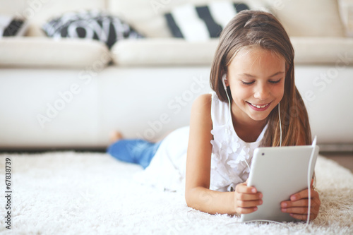 Pre teen girl with tablet pc - 67838739