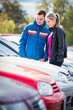 Young couple choosing the right car for them