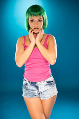 Cute slender young woman with green hair
