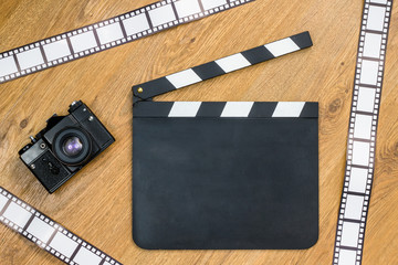 Blank film slate, vintage camera and film