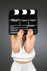 Kid holding clapper board