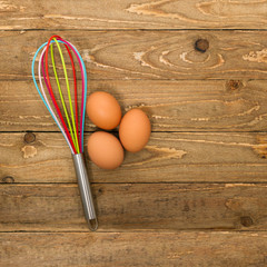 Kitchen whisk and eggs