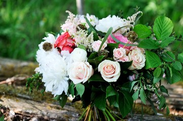 Colorful bouquet with white peony and pink roses