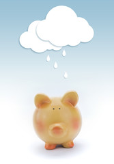 Piggy bank with paper cloud and rain above.