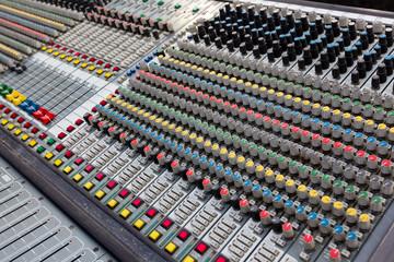 Closeup of buttons of a studio mixer