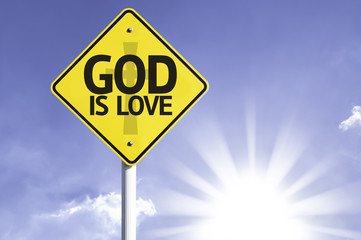 God is Love road sign with sun background