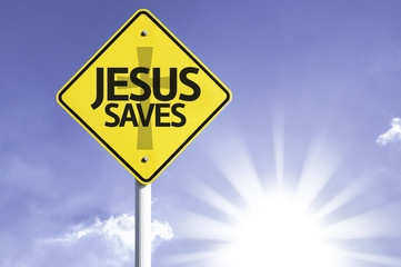 Jesus Saves road sign with sun background