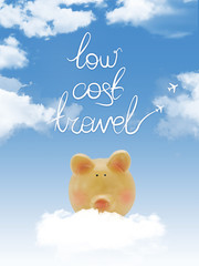 "Piggy bank on a cloud with ""low cost travel"" textand blue sky"