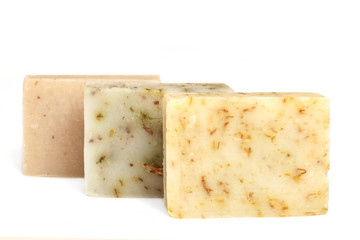 bars of natural soap with dried herbs