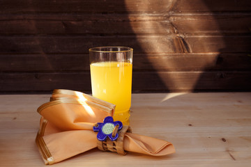 Delicious fruit juice on wooden table, close-up