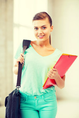 student girl with school bag and color folders
