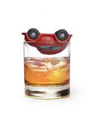 toy car on whiskey glass as traffic accident due to alcohol